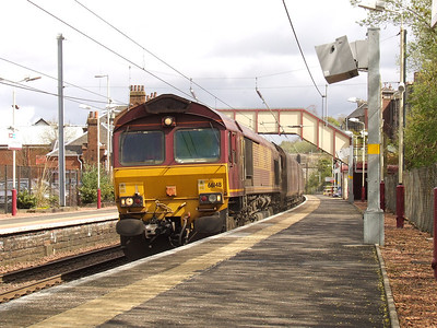 66148 passing through Johnstone with empty coal hoppers en route to Hunterston
