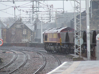 66234 passing through Paisley Gilmour Street in the driving rain