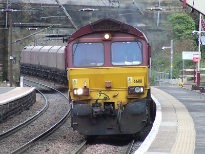 66118 passing through Johnstone with empty coal hoppers en route to Hunterston