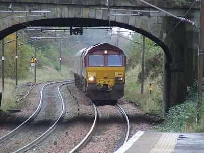 66166 about to pass through Johnstone with empty coal hoppers on a working to Hunterston