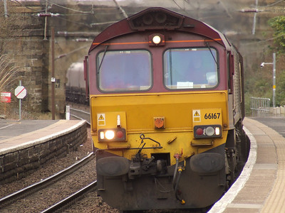 66167 passing through Johnstone with empty coal hoppers en route to Hunterston
