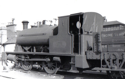 Drummond Caledonian Pug 0-4-0ST 16037 at Princes Pier Shed on 4th August 1932. It was built at St Rollox in Dec 1902 for the Caledonian Railway as CR 628 as part of the 624 Class. On grouping it became LMS 16037 and was classed as 0F. The engine was withdrawn in December 1935 at Greenock Princes Pier and sold to Bent Colliery,Cadzow, and in April 1945 it was sold on to Stewarts & Lloyds. The engine was cut up in June 1956