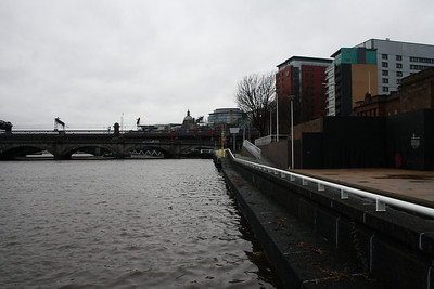 Exceptionally high tide on 3rd January 2014, caused by a tidal surge and prolonged periods of rain and storm force weather from the Atlantic. This is the Clyde Walkway at Custom House Quay Gardens